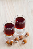 Two glasses with hazelnut liqueur Royalty Free Stock Image