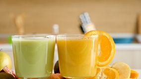 Two glasses with healthy and organic smoothies. In the kitchen. Dolly close up shot from left to right stock video