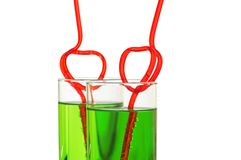 Two glasses with heart straws Royalty Free Stock Images