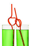 Two glasses with heart straws Royalty Free Stock Photos