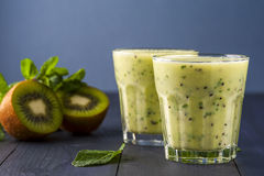Two glasses of homemade smoothie with kiwi Stock Image