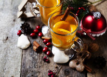 Two glasses of hot tea with christmas decoration Stock Photography