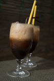Two glasses of ice coffee with milk with straws Stock Images