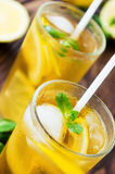 Two glasses of ice tea with ice-cubes Royalty Free Stock Image