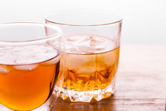 Two glasses with ice and whiskey Stock Photo