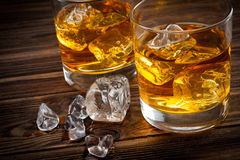 Two glasses with ice and whiskey Stock Image