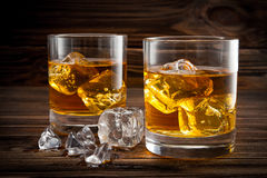 Two glasses with ice and whiskey Royalty Free Stock Photography