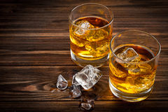 Two glasses with ice and whiskey Royalty Free Stock Photo