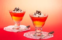 Two glasses of jelly with the whipped cream Royalty Free Stock Photography