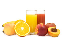 Two glasses of juice and fresh fruits Royalty Free Stock Photo