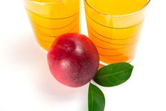 Two glasses of juice and fresh peaches  on white background.  Royalty Free Stock Images