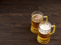 Two glasses of lager served on old wooden planks, copyspace for text royalty free stock photo