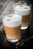 Two glasses of latte Stock Images