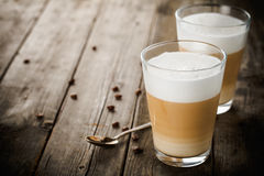 Two glasses of latte stock image