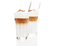 Two glasses latte macchiato with chocolate powder Royalty Free Stock Photos