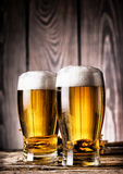Two glasses of light beer with foam Royalty Free Stock Image