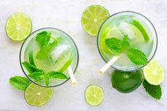 Two glasses of limeade with mint, top view on marble Royalty Free Stock Photography