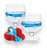 A two glasses of liqueur with two hearts. Royalty Free Stock Photos