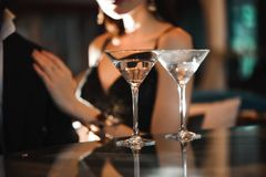 Two glasses of martini coctail in a bar. Two glasses of martini coctail in a bar stock images