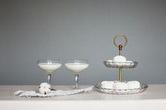 Two glasses of milk with a cotton flower Royalty Free Stock Image