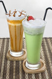 Two Glasses of Mocca and Green Tea Smoothies Royalty Free Stock Photos
