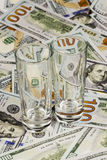 Two glasses and money. Two empty glasses stand next to each other on dollar bills Stock Images
