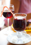 Two glasses with mulled wine. In cafe Royalty Free Stock Image