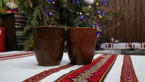 Two glasses of mulled wine on the background of Christmas garland and colorful lights. Concept of a happy winter holiday or new ye. Concept of a happy winter stock video