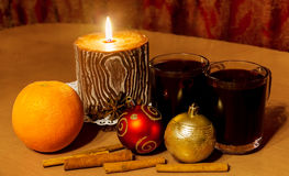 Two glasses of mulled wine and candle Stock Image