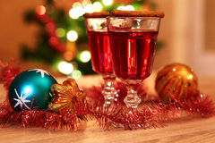 Two glasses of mulled wine with christmas baubles Royalty Free Stock Images