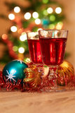 Two glasses of mulled wine with christmas baubles Stock Image