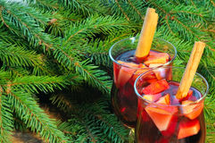 Two glasses of mulled wine and christmas tree branches Royalty Free Stock Images
