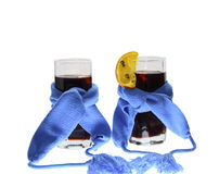 Two glasses of mulled wine dark blue scarfs Royalty Free Stock Images