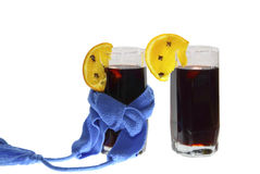 Two glasses of mulled wine dark blue scarfs Stock Photos