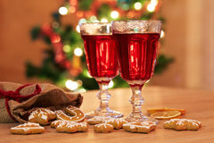 Two glasses of mulled wine with gingerbread and spices Royalty Free Stock Photo
