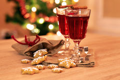 Two glasses of mulled wine with gingerbread and spices Stock Photo