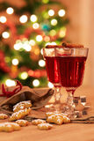 Two glasses of mulled wine with gingerbread and spices Stock Photos