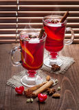 Two glasses of mulled wine  on old wooden table Royalty Free Stock Photo