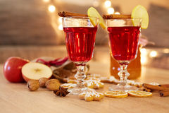 Two glasses of mulled wine with orange and spices Royalty Free Stock Images