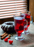 Two glasses of mulled wine with red hearts Royalty Free Stock Images