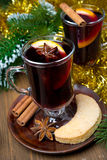 Two glasses of mulled wine with spices in glass and cookies Stock Image