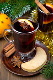 Two glasses of mulled wine with spices in glass and cookies Royalty Free Stock Images