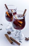 Two glasses of mulled wine and spices isolated. Two glasses of hot wine and spices on white background Royalty Free Stock Photography