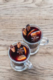 Two glasses of mulled wine on the wooden background Stock Photo
