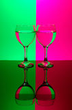 Two glasses on neon background Stock Photography