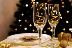 Two glasses on new year decorated table. Wih bokeh background Royalty Free Stock Photo