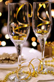 Two glasses on new year decorated table. Wih christmas tree bokeh background Stock Images
