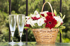 Two Glasses Of Champange And Flower Basket With Plain Envelope Stock Image