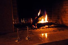 Two Glasses Of Wine Near The Fireplace Stock Photo