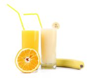 Two glasses of orange juice and banana juices. Two glases of orange juice and banana juices on a white royalty free stock photo